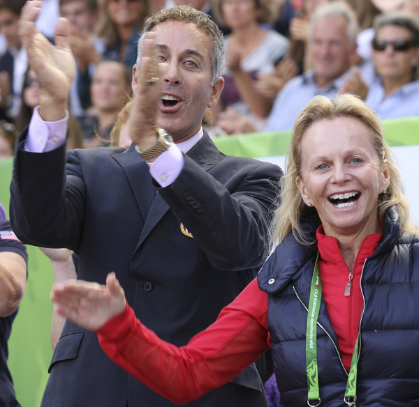 Debbie McDonald and Robert Dover cheering on American combinations at the World Equestrian Games in Normandy. © 2014 Ilse Schwarz/dressage-news.com