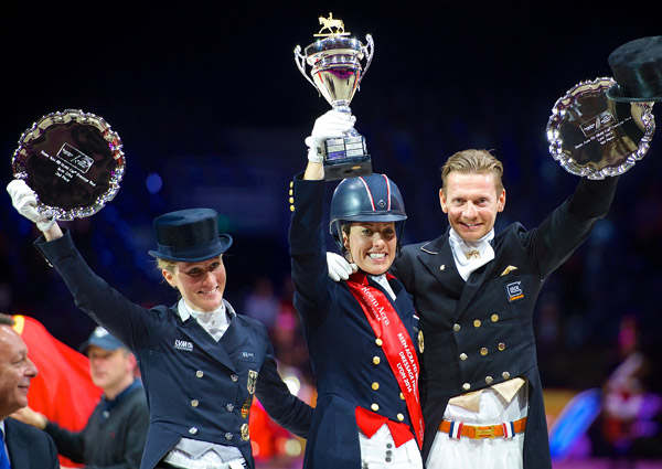 World Cup 2014 champion Charlotte Dujardin of Great Britain (centet), German runner-up Helen Langehanenberg (left) and third-placed Edward Gal of the Netherlands. © 2014 FEI/Arnd Bronkhorst