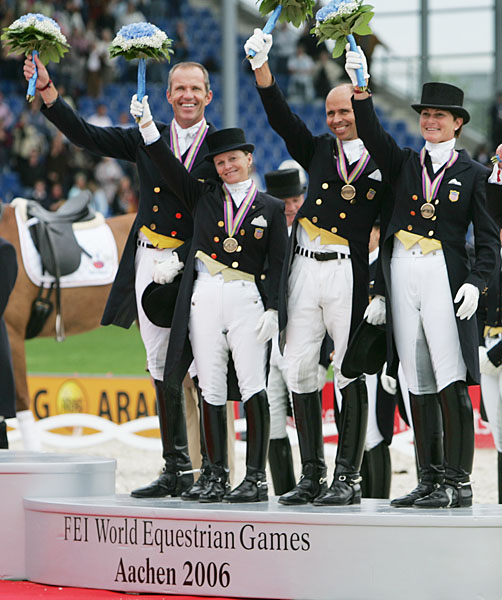 The last United States team on an Olympic or World Games medals podium--the bronze medal team of Günter Seidel, Debbie McDonald, Steffen Peters and Leslie Morse at the 2006 World Equestrian Games. © Ken Braddick/dressage-news.com