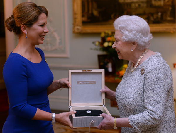 Queen Elizabeth II receiving the first FEI Lifetime Achievement award from FEI President Princess Haya at a ceremony in Buckingham Palace. © 2014 Press Association