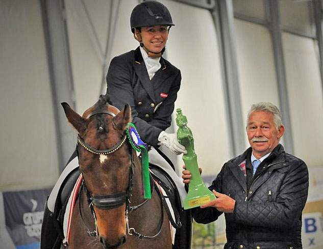 Karin Kosak of Austria on Florentino receiving award from judge Stephen Clarke. © 2014 dressage24.pl
