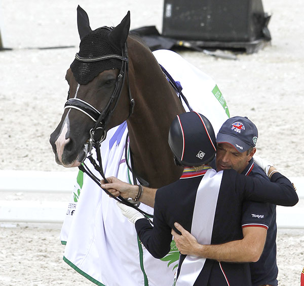 Alan Davies, who takes care of Valegro, getting a hug from Charlotte. Alan was also nominated as International Equestrian Federation Groom of the Year. © 2014 Ken Braddick/dressage-news.com