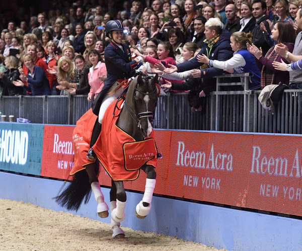 Charlotte Dujardin on Valegro celebrating their Freestyle world record. © 2014 Kit Houghton/HPower