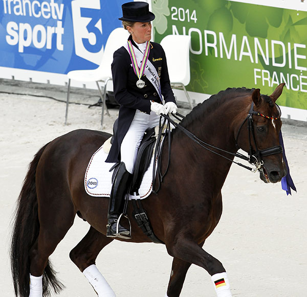 Helen Langehanenberg riding Damon Hill out of the competition arrena for the last time. © 2014 Ken Braddick/dressage-news.com