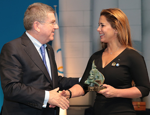 Princess Haya received International Olympic Trophy from Thomas Bach, president of the International Olympic Committee. © 2014 IOC/Ian Jones