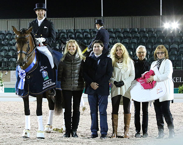 Kim Boyer, standing next to Grandioso, presenting awards to the top placegetters in the World Cup Grand Prix Special at the Adequan Global Dressage Festival that was won by her Grandioso ridden by José Daniel Martín Dockx. © 2015 Ken Braddick/dressage-news.com