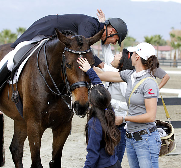 Steffen on Rosamunde being congratulated by Akiko Yamazaki with Dawn White-O'Connor, his assistant and Miki Yamazaki. © 2015 Ken Braddick/dressage-news.com