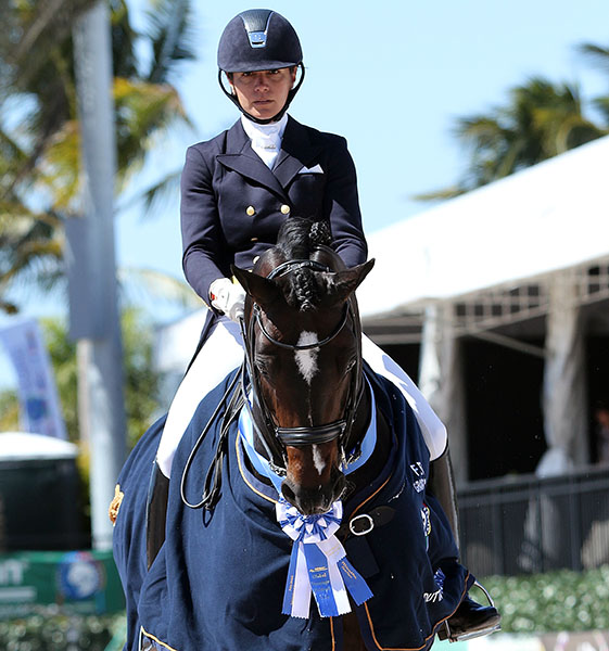 Allison Brock on Rosevelt celebrating victory at the Global Dressage Festival in Wellington. © 2015 Ken Braddick/dressage-news.com