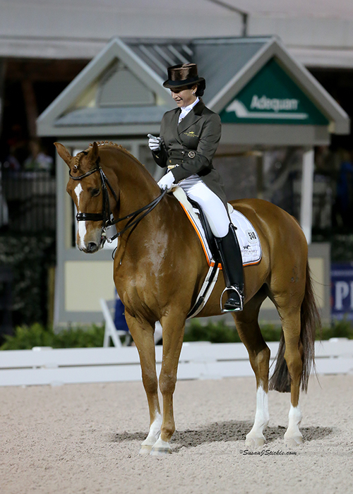Catherine Haddad-Staller wagging a finger at Mane Stream Hotmail at the the end the ride in the CDI5* Grand Prix Freestyle where the horse spooked. © 2015 SusanJStickle.com