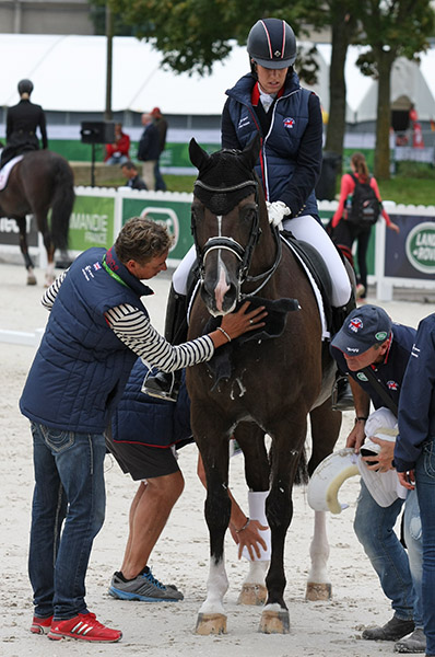 Valegro with Charlotte Dujardin aboard and Carl Hester making final preparations for competition. © Ilse Schwarz/dressage-news.com
