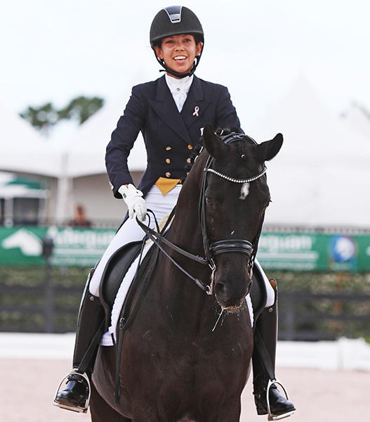 Chase Hickok on Sagacious HF on completing the pair's 10th straight CDI Under-25 victory. © 2015 Ken Braddick/dressage-news.com