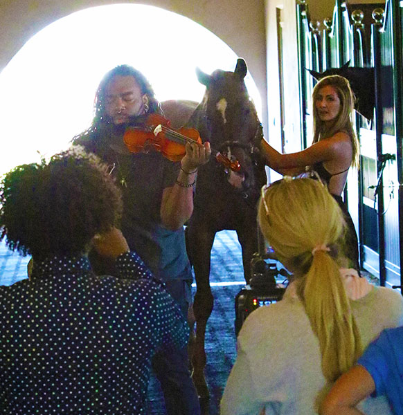 D Sharp performing with Caroline Roffman with producer Malkio Rollins and Johnny Robb who organized the video shoot. © 2015 Ken Braddick/dressage-news.com