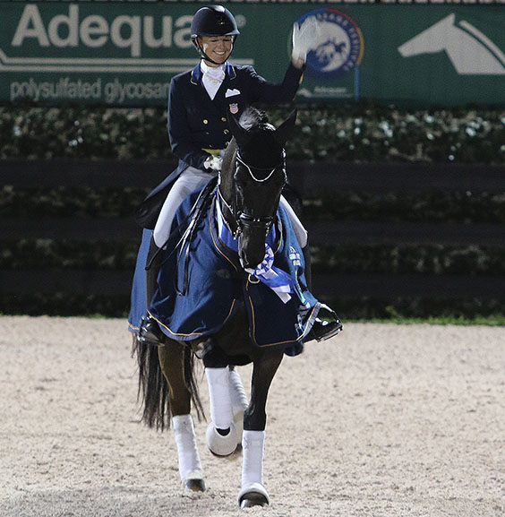 Katherine Bateson-Chandler on Alcazar wearing the winner's blue ribbon and award blanket after the pair's victory in the Adequan Gobal Dressage Festival World Cup Grand Prix Special. © 2015 Ken Braddick/dressage-news.com
