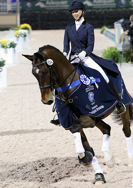 Laura Graves on Verdades celebrating their Wellington World Cup victory and their first ever win at Grand Prix level. © 2015 Ken Braddick/dressage-news.com
