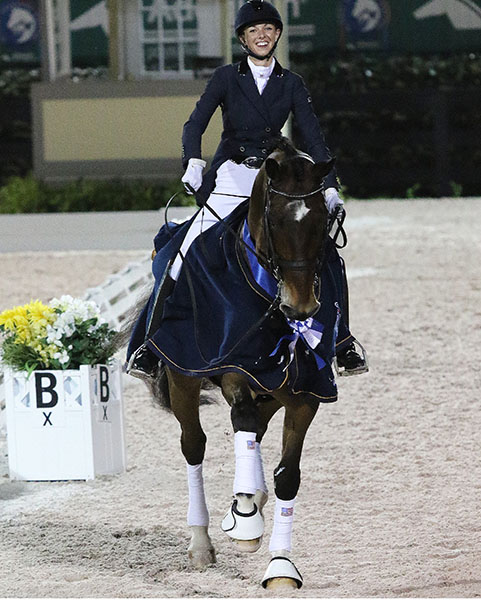Laura Graves on Verdades enjoying their victory in the World Cup Grand Prix Freestyle. © 2015 Ken Braddic/dressage-news.com