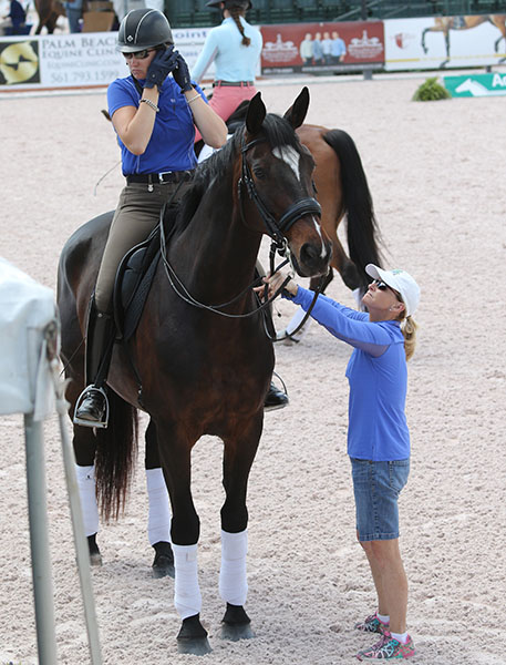 Debbie McDonald helping prepare Silva Martin on Saphira for a coaching session. © 2015 Ken Braddick/dressage-news.com