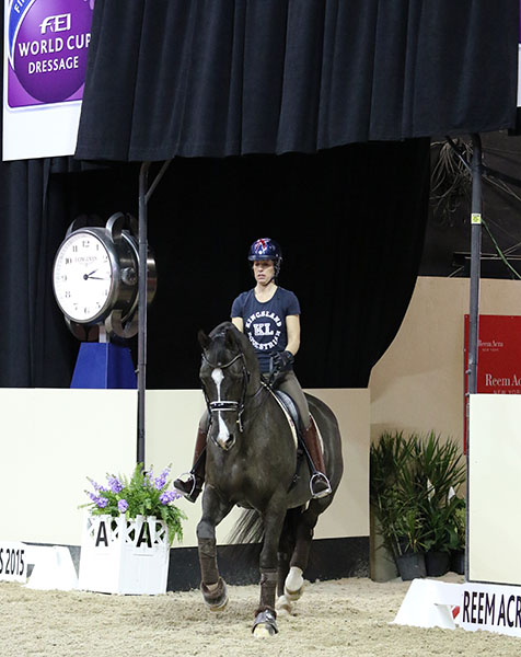 A roar went up from the fans when Charlotte Dujardin and Valegro appeared in the competition arena for a few minutes of training--with horse owner and trainer/mentor Carl Hester providing guidance by radio. © 2015 Ken Braddick/dressage-news.com