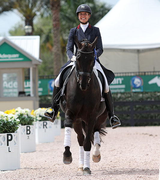 Charlotte Jorst and Kastel Adventure celebrating success in Forida. © 2015 Ken Braddick/dressage-news.com