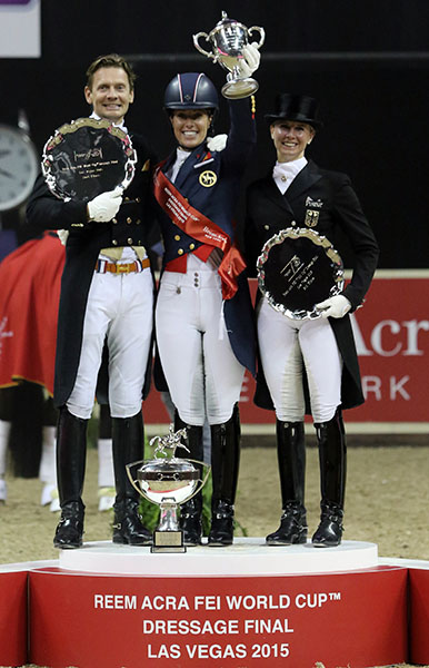 Charlotte Dujardin with Edward Gal and Jessica von Bredow-Werndl holding aloft the 2015 World Cup at the Final in Las Vegas that was the richest dressage competition in 2015.. © 2015 Ken Braddick/dressage-news.com