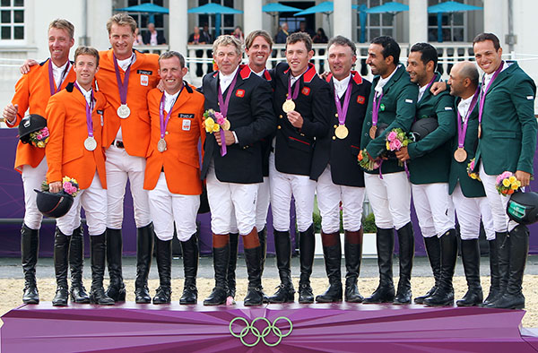 Jumper teams on the medals podium at the 2012 Olympic Games--Netherlands (orange), Great Britain (dark blue) and Saudi Arabia (green). © Ken Braddick/dressage-news.com