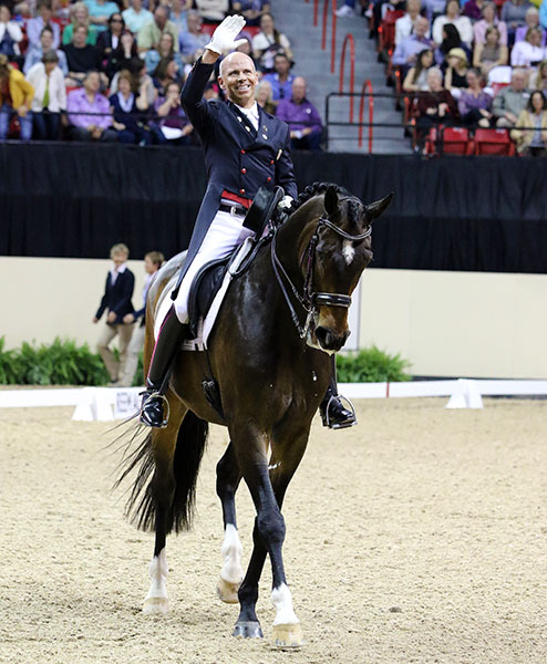 Steffen Peters on Legolas at the end of their ride enjoying the sustained and loud acclaim of the fans before leaving the arena. © 2015 Ken Braddick/dressage-news.com