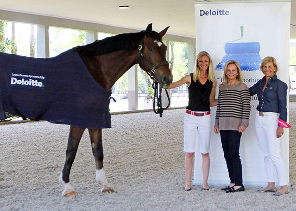 Verdades wary of the banner behind Laura Graves, Debbie McDonald and Judy Sloan. © 2015 Ken Braddick/dressage-news.com