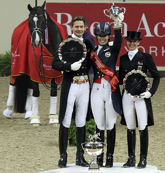 Valegro--star of the World Cup Finals--looks on as rider Charlotte Dujardin, Edward Gal and Jessica von Bredow-Werndl receive the silverware. © 2015 Ilse Schwarz/dressage-news.com