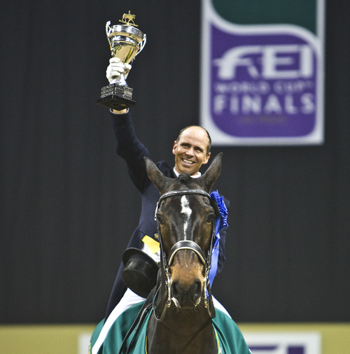 Steffen Peters on Ravel holding aloft the World Cup in 2009. © Ken Braddick/dressage-news.com