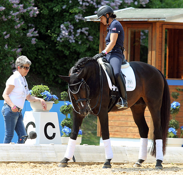 Allison Brock on Rosevelt getting advice from Kyra Kyrklund. © 2015 Ken Braddick/dressage-news.com