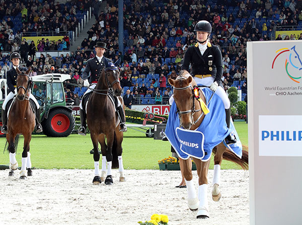 Isabell Werth on Don Johnson, Steffen Peters on Legolas and Tinne Vilhelmson-Silfvén on Don Auriello at the CDI5* Grand Prix awards ceremony on the dressage arena in the Aachen Main Stadium. © 2015 Ken Braddick/dressage-news.com