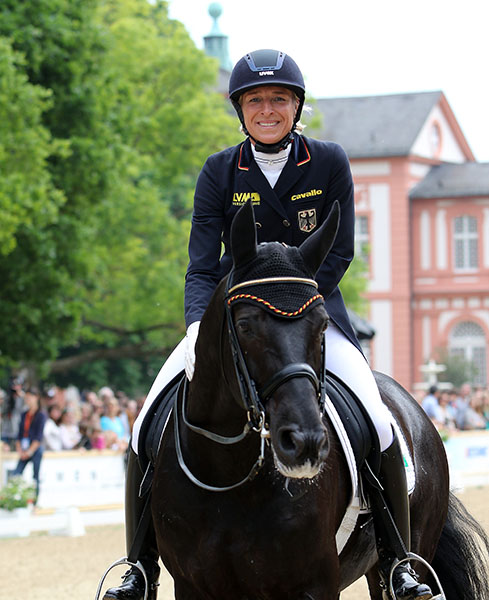 An obviously happy Ingred Klimke on Dresden Mann after their CDI4* Grand Prix at Wiesbaden. © 2015 Ken Braddick/dressage-news.com