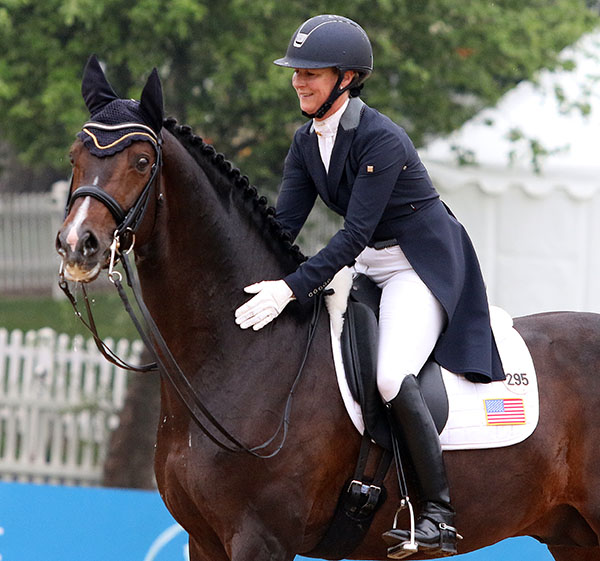 A smiling Sabine Schut-Kery at the end of the Intermediate 1 ride, but Sanceo is not so sure about the photographer. © 2015 Ken Braddick/dressage-news.com