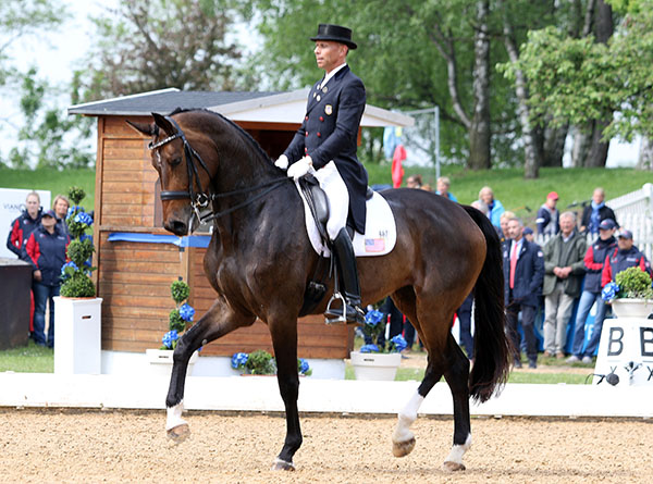 Steffen Peters riding Rosamunde to second place in the Munich CDI3* Grand Prix, the eight-year-old mare's first European Big Tour event. © 2015 Ken Braddick/dressage-news.com