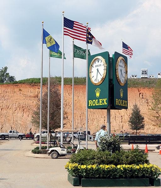 The hillside overlooking Tryon International Equestrian Centere where the spa resort hotel will be built. Although this already is among the world's best show grounds, that big green Rolex clock marks the venue the same as Lexington, Kentucky and Wellington, Florida--not Longines so not acceptable. © 2015 Ken Braddick/dressage-news.com