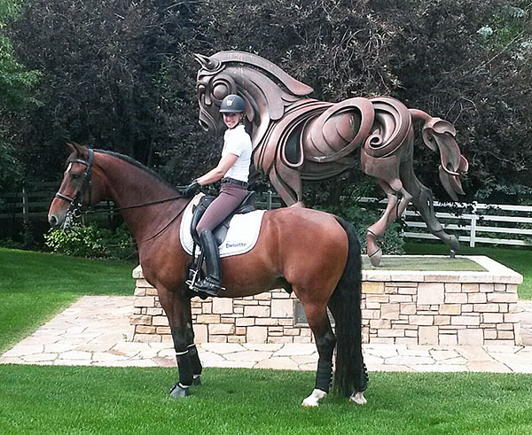 "Laura Graves on Verdades beside ""Brentina"" sculpture at River Grove Farm in Hailey, Idaho."