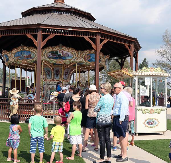 Free carouself rides popular with children. © 2015 Ken Braddick/dressage-news.com