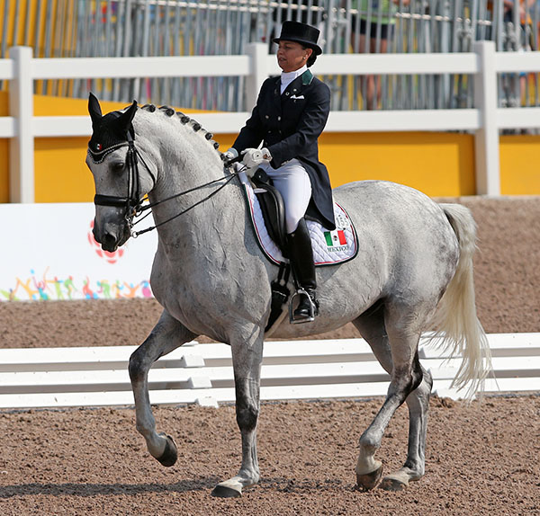 "Bernadette Pujals on Heslegaards Rolex whose ""bonus"" points added to their Grand Prix score put Mexico in the bronze medal position on the first of two days of Pan American Games Nations Cup competition. © 2015 Ken Braddick/dressage-news.com"
