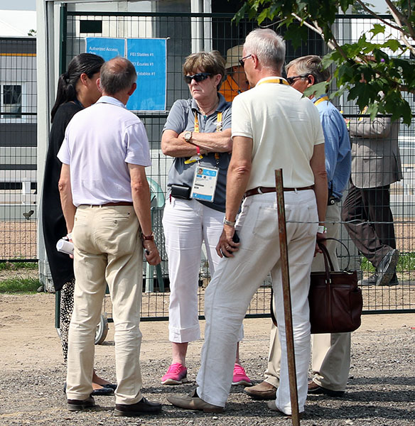 Pan American Games and International Equestrian Federation officials in one of the many huddles throughout Monday trying to resolve an issue over the individual medal Freestyle start list that several nations said should never have been an issue. © 2015 Ken Braddick/dressage-news.com