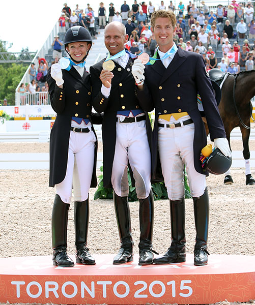 Pan American Games individual gold medalists Laura Graves (silver), Steffen Peters (gold) and Chris Von Martels (bronze). © 2015 Ken Braddick/dressage-news.com