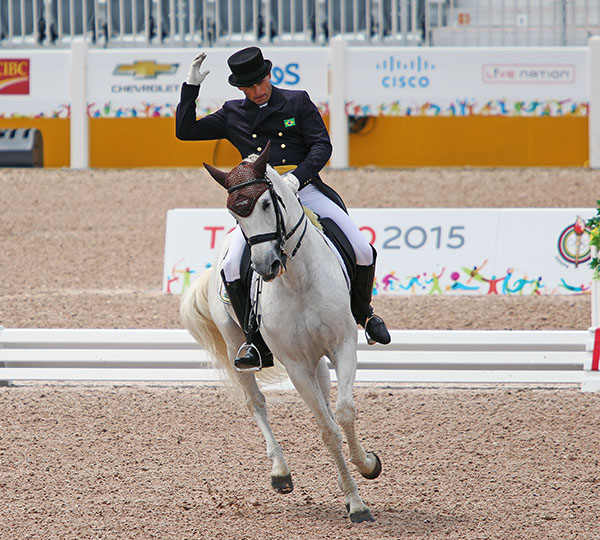Joao Paulo Dos Santos on Veleiro do Top brought a dramatic flourish to the Pan American Games individual medal compegtition. © 2015 Ken Braddick/dressage-news.com