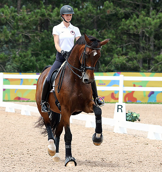 "Laura Graves on a ""different"" Verdades schooling at the Pan American Games. © 2015 Ken Braddick/dressage-news.com"