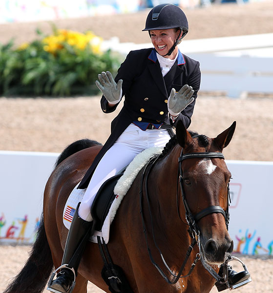 Laura Graves on Verdades enjoying success at the Pan American Games where she was on the United States team that won gold and earned a start at the Olympics in Rio de Janeiro. © 2015 Ken Braddick/dressage-news.com