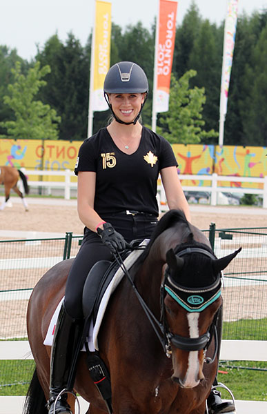 The shirt worn by Megan Lane on Caravella at the Caledon Pan Am show grounds needs no explanation--a gold maple leaf. © 2015 Ken Braddick/dressage-news.com
