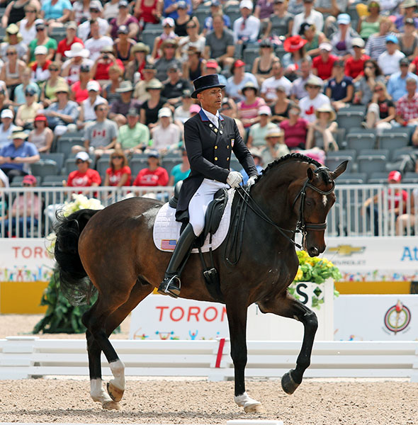 Steffen Peters and Legolas completing their Pan American Games individual gold medal Freestyle ride. © 2015 Ken Braddick/dressage-news.com