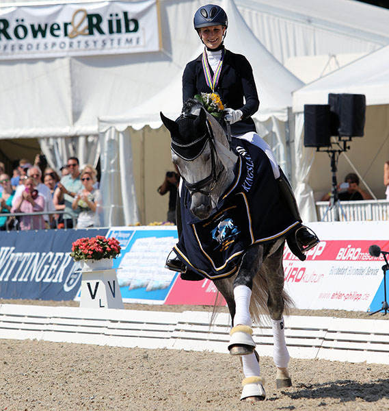 Beatrice Buchwald and Belantis enjoying the celebration of their silver medal in the World Six Year Old Championship. © 2015 Ken Braddick/dressage-news.com