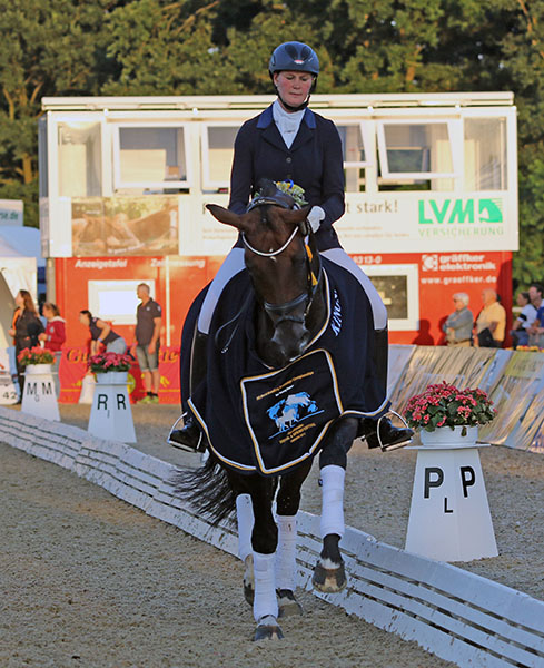 "Claudia Rüscher of Germany on Florina, winners of the ""small"" final for five-year-old horses. © 2015 Ken Braddick/dressage-news.com"