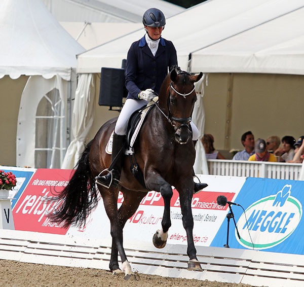 Claudia Rüscher and Florina had to compete in two qualifiers to make it to the World Young Horse five-year-old Championship but in their third competition in three days placed fourth. © 2015 Ken Braddick/dressage-news.com