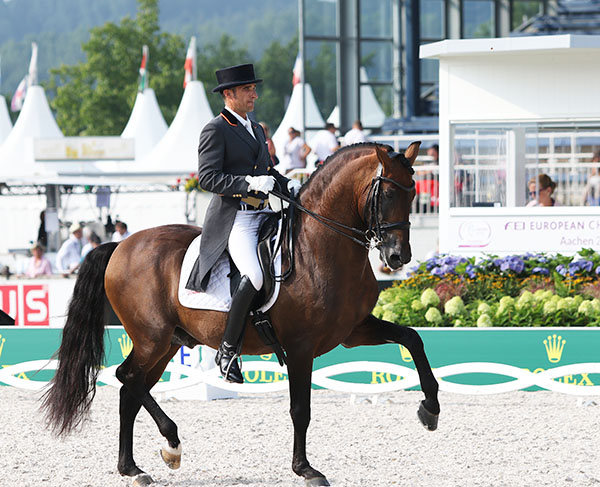 Jose Daniel Dockx riding Grandioso in the European Championships Nations Cup. © 2015 Ken Braddick/dressge-news.com