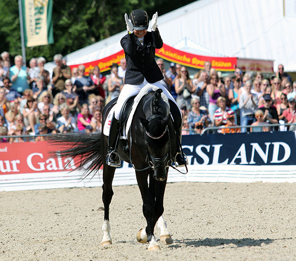 Dorothee Schneider on Sezuan at the end of teir ride to win the World Six Year Old Championship. © 2015 Ken Braddick/dressage-news.com