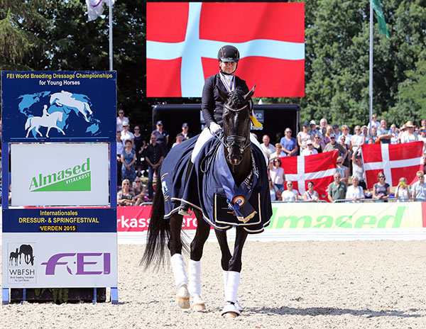 The photo for the souvenir book of Dorothee Schneider and Sezuan at the awards ceremony. The pair did it at the same show grounds a year earlier when they were both a year younger. © 2015 Ken Braddick/dressage-news.com